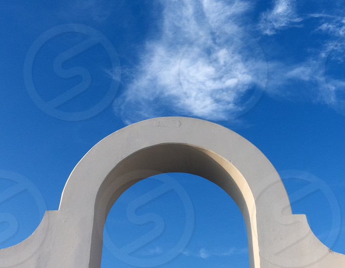 Close up of an architectural arch in the Italian seaside town of Sperlonga. photo