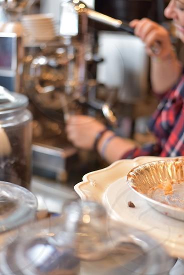 Barista preparing espresso at cafe photo