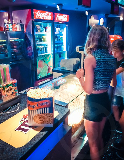 Customers Buying Pop Corn And Beverages At The Cinema photo