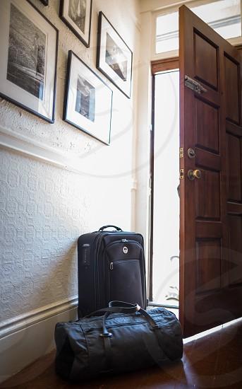 black bags beside door photo
