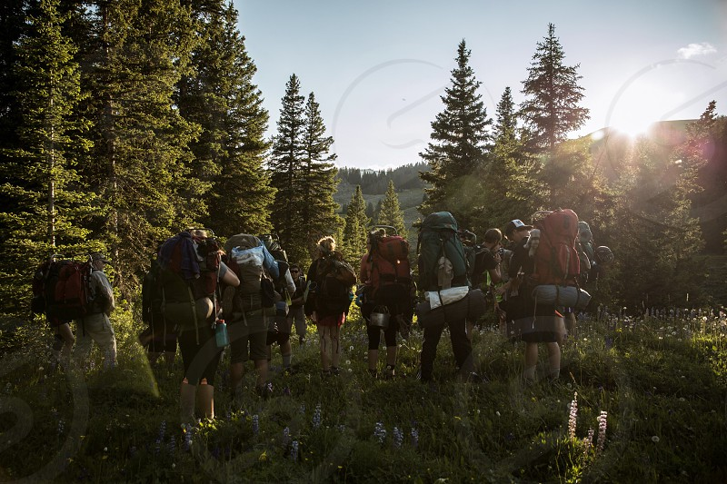 people hiking with backpacks photo