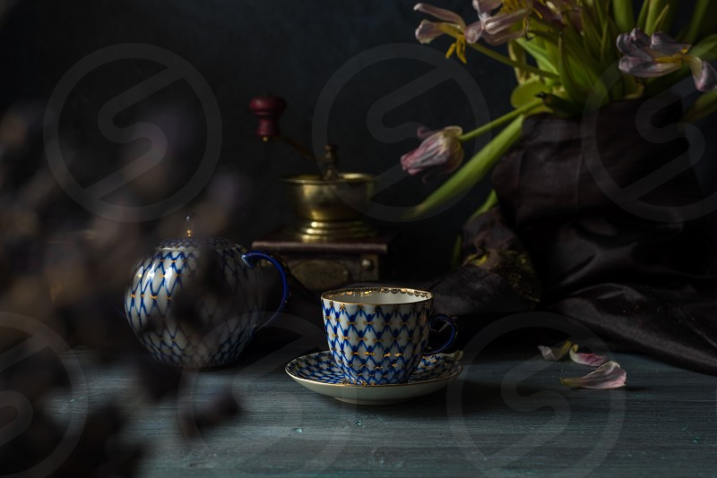 Still life with cups and coffee mill photo