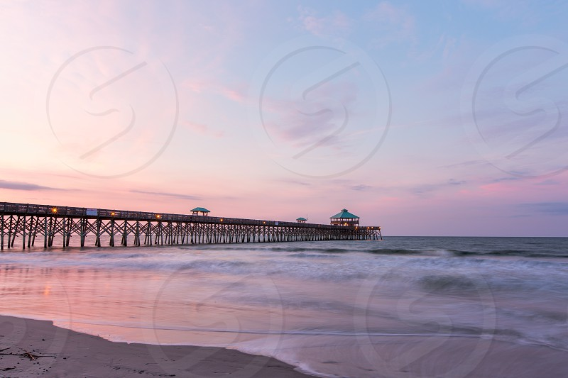 The sunrise at Folly Beach pier in South Carolina long exposure photo