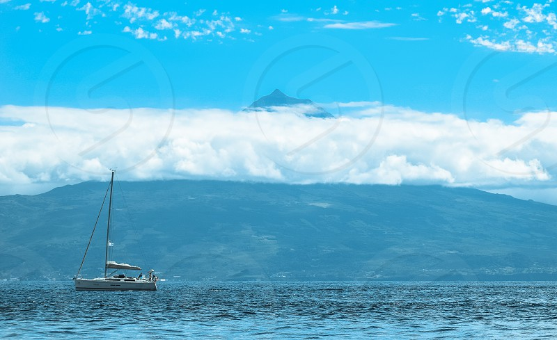 white sailboat on the photo