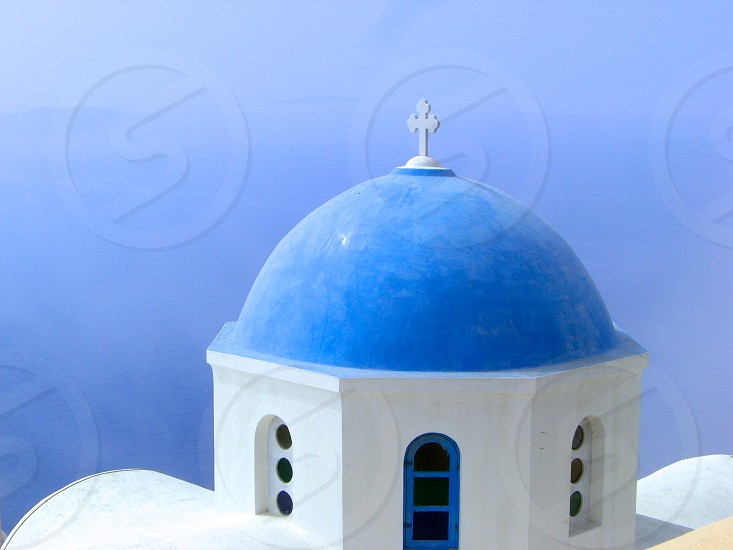 Blue roof white building in Santorini Greece photo