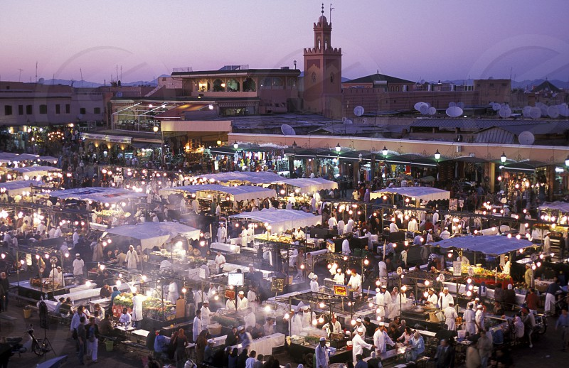 The Streetfood and Nightlife at the Djemma del Fna Square in the old town of Marrakesh in Morocco in North Africa. photo