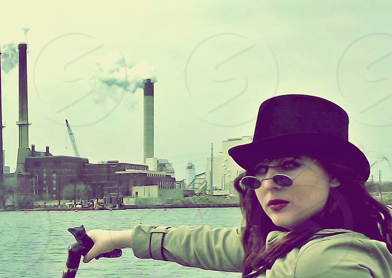 woman in black top hat wearing black round sunglasses photo