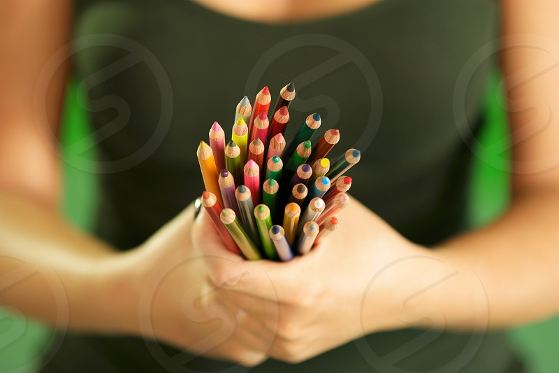 pencil pencils woman art artist showing show adult caucasian closeup color colorful colour concept craft create creative creativity draw drawing female girl green group hand hands hobby holding idea image imagination indoor inspiration job leisure object objects occupation one painter painting people person profession vision white work young photo