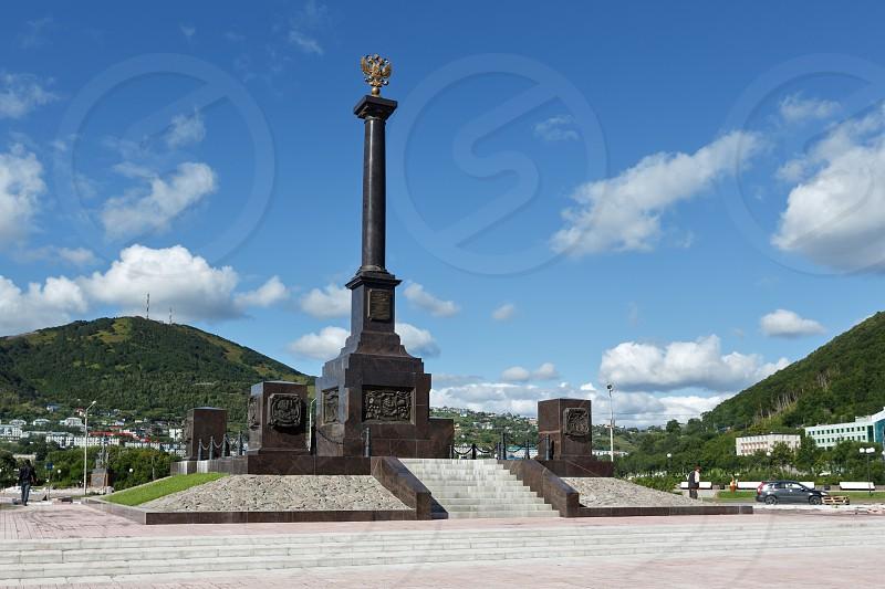 PETROPAVLOVSK-KAMCHATSKY KAMCHATKA RUSSIA - SEP 07 2015: Scenic view of the stela City of Military Glory on the Petropavlovsk-Kamchatsky City on a sunny day. Russia Far East. photo