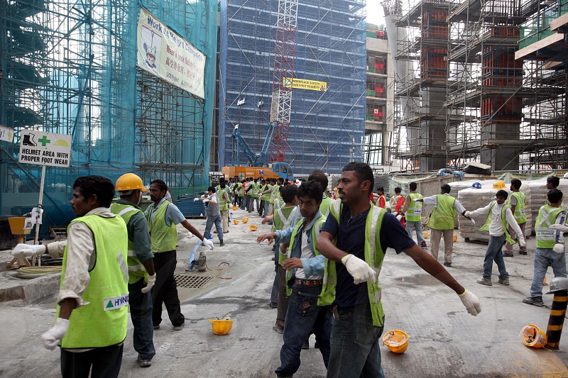 workers from asian countrys on a construction side at a wormup in the city of Singapore in Southeastasia. photo