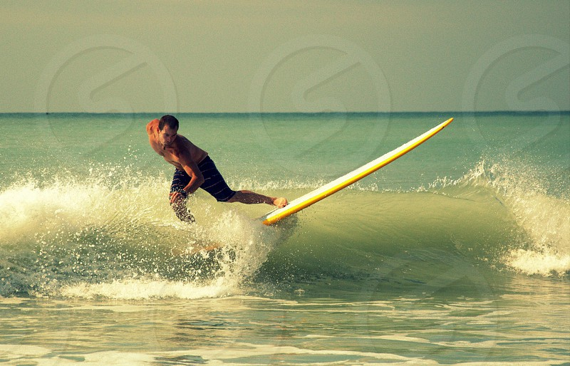 surfing a wave of happiness photo