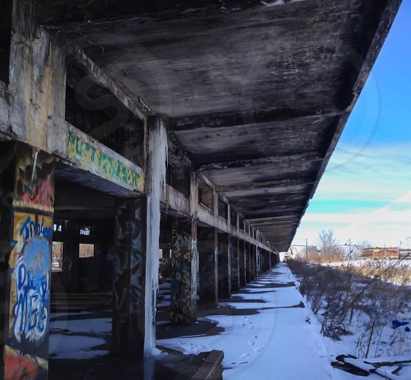 grey concrete building with graffiti photo