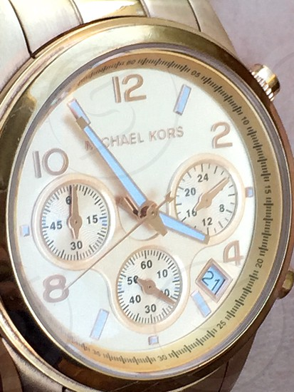 round white Michel Kors chronograph watch with link bracelet photo