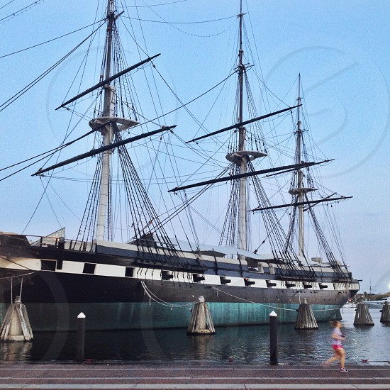 The historic ship USS Constellation in Baltimore's Inner Harbor. Baltimore water harbor boat ship history masts blue fitness runner photo