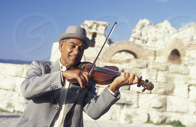 streetmusic in the ruin of the Basilica in the old town of  Nesebar on the coast of the Black sea in Bulgaria in east Europe. photo