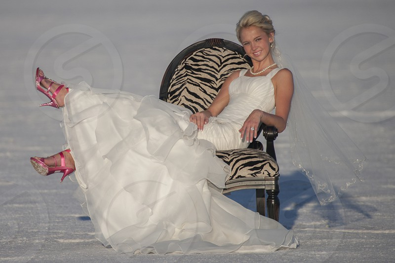Bride posing in chair on playa.  photo
