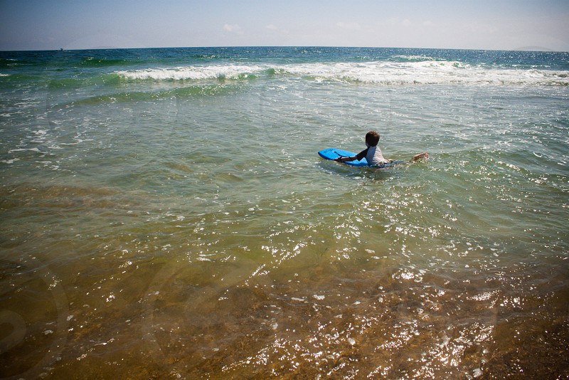 ocean boogie board kid boy beach shore photo