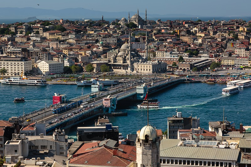 Architecture in Old Istanbul. Galata Bridge and New Mosque. photo