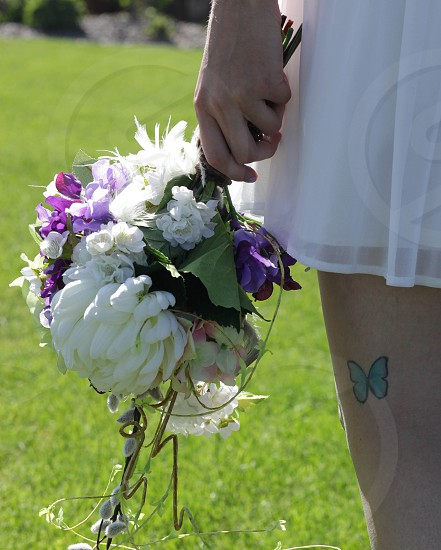 Butterfly tattoo on bride photo
