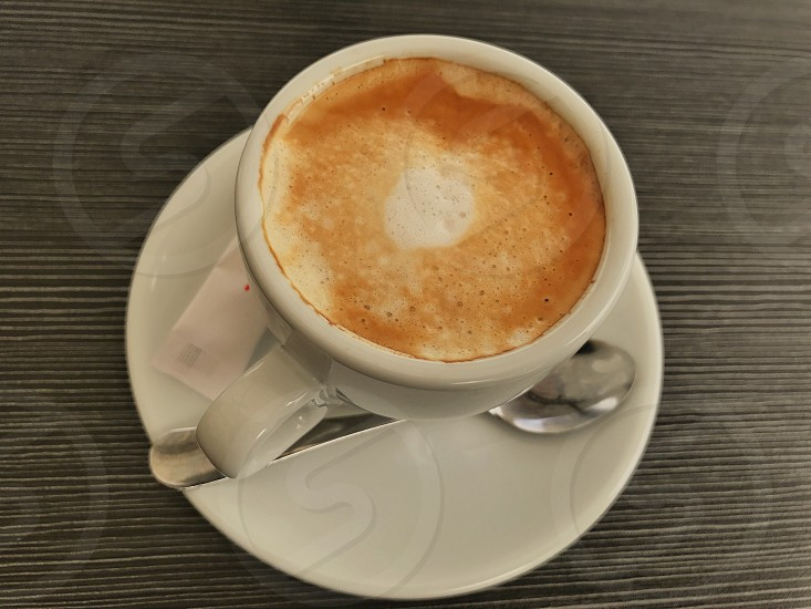 Coffee latte cup milk art photo