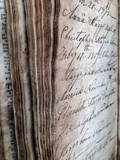 Antique book with hand written names and dates photo