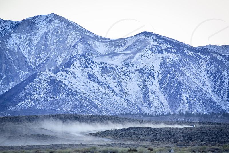 car dust mountains dirt road photo