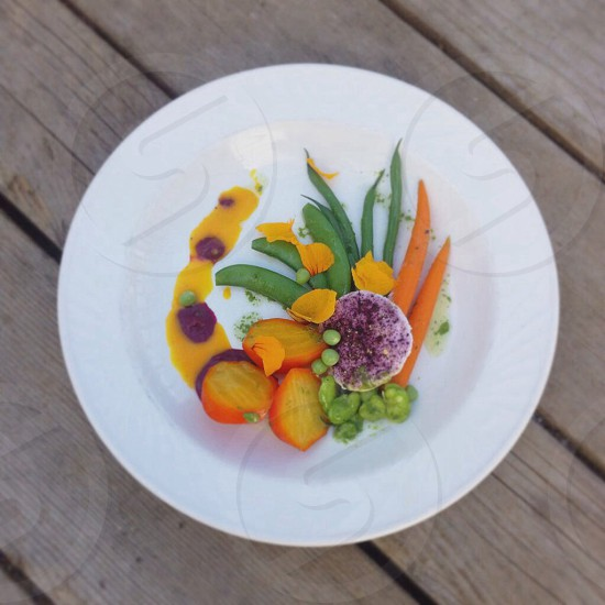 green beans orange sliced carrots on white ceramic plate photo