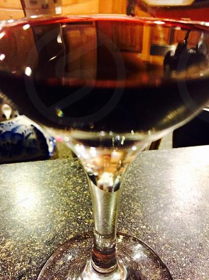 glass of wine in closeup photo photo