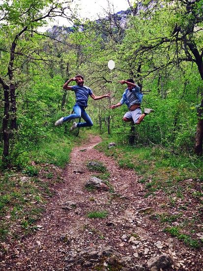 two people doing jump shot on forest way photo