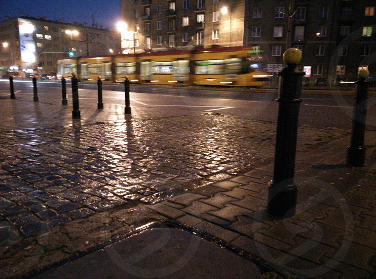 City street at night after rain. Warsaw Poland photo