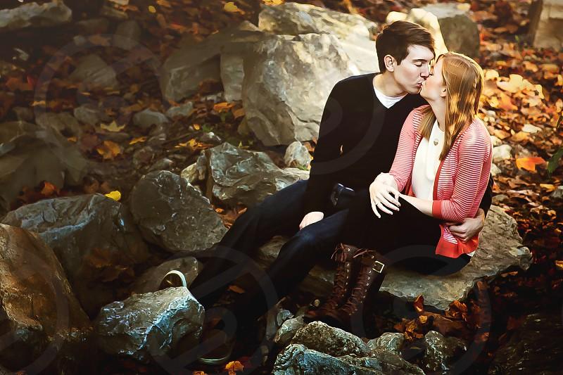 couple kissing on rocks photo