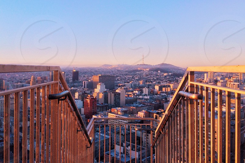 staircase handrails overlooking large city photo