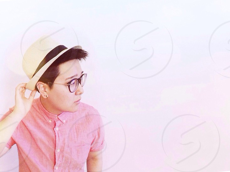 Man Wearing Pink Collared Shirt and White and Black Hat photo