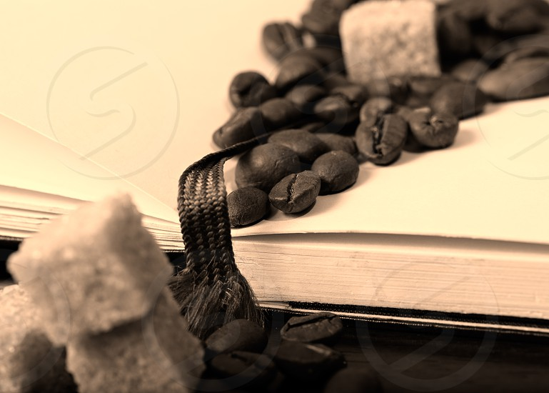 Coffee beans on paper sepia background old photo style. photo