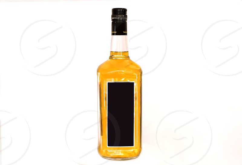 A bottle of scotch on a white background photo