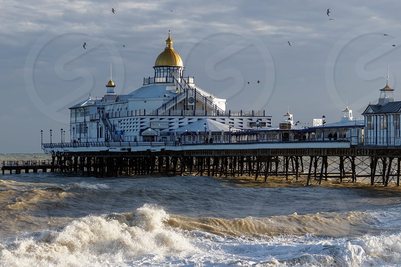 EASTBOURNE EAST SUSSEX/UK - JANUARY 7 : View of Eastbourne Pier in East Sussex on January 7 2018. Unidentified people photo