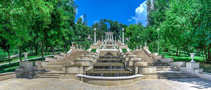 Chisinau Moldova – 06.28.2019. Fountains and the cascading stairs near the Valea Morilor Lake in Chisinau Moldova on a sunny summer day photo