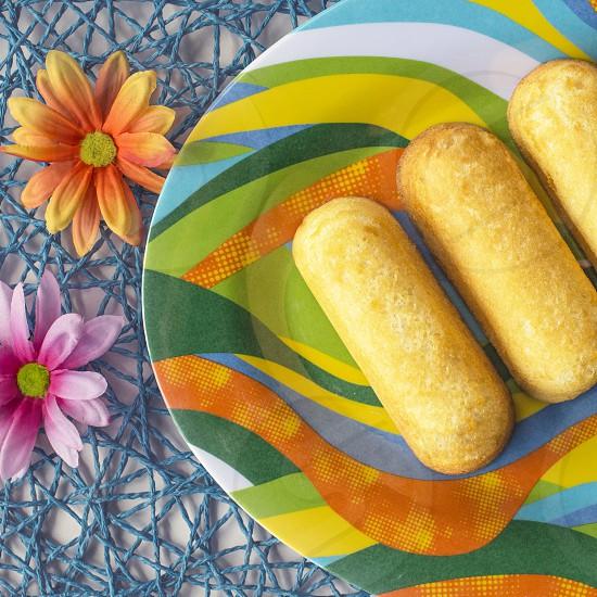 baked bread on plate near flower ornaments photo