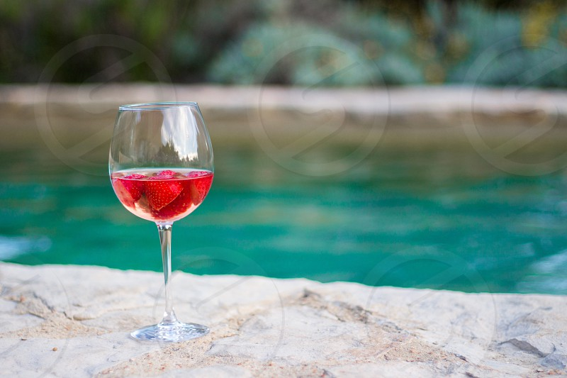Wine glass strawberry wine pool water holidays vacation copy space relaxation summer photo