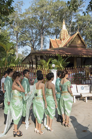 people at the Preah Angchek or Preah Ang Chorm Shrine in the city of Siem Reap in northwest of Cambodia.   Siem Reap Cambodia November 2018 photo