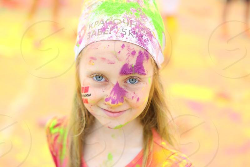 Beautiful little girl. Color run. Childhood. photo