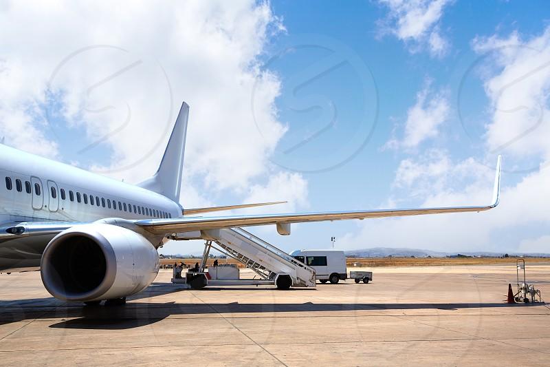 Aircraft airplane in Airport landed with blue sky photo