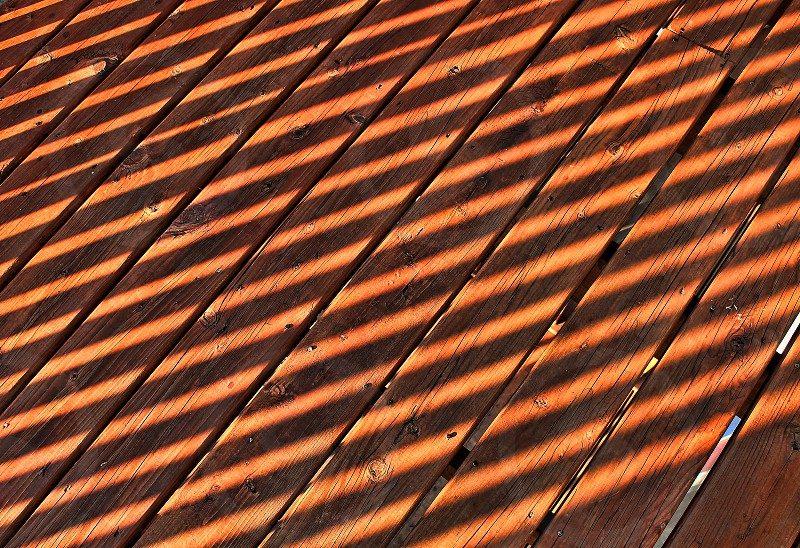 Pattern of shadows on a wooden deck photo