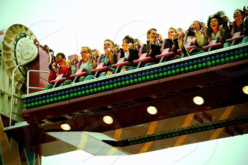 People enjoying a lunapark ride at Oktoberfest. photo