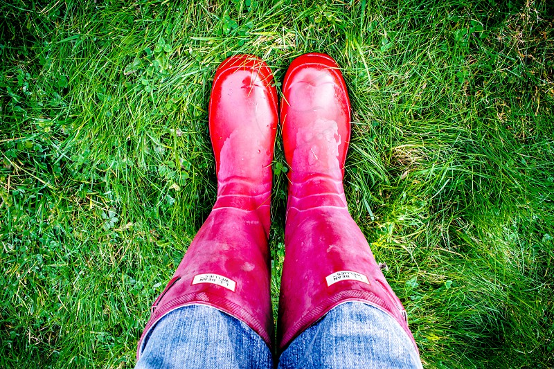 person wearing red boots photo