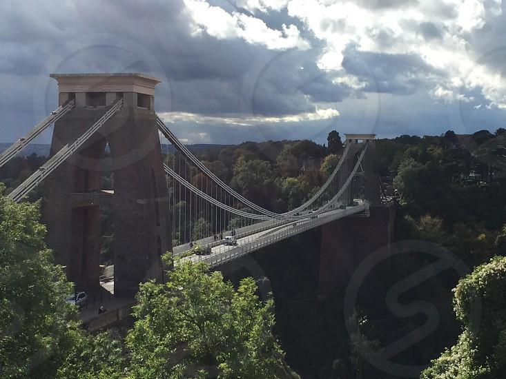 gray bridge under gray clouds photo
