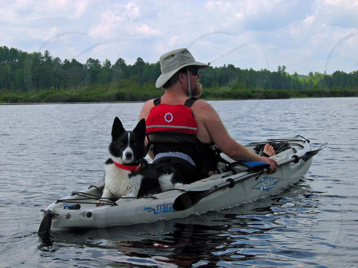 man and dog on gray kayak photo