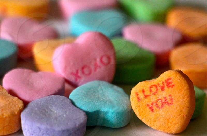 orange i love you and pink xoxo conversation hearts with purple blue and green upside down hearts photo