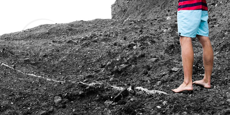 Laguna beach boy black rocks negative space photo