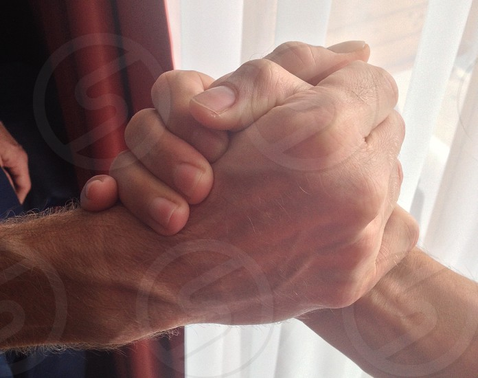 2 human hands during daytime photo